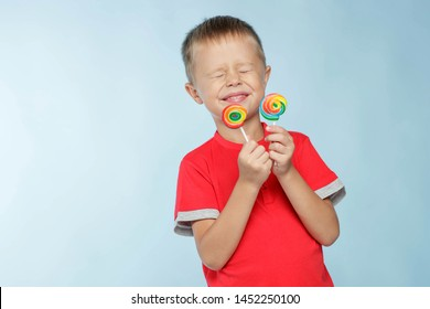 A child with candy. A little boy is holding candy in his hands.