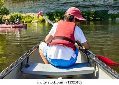 A child canoeing on the Dordogne river, France