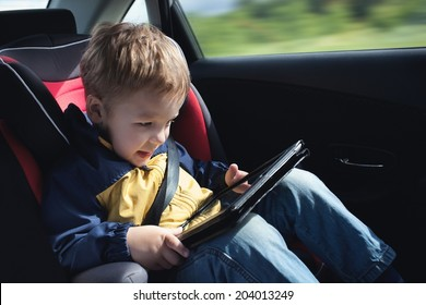 Child in the car with tablet PC
