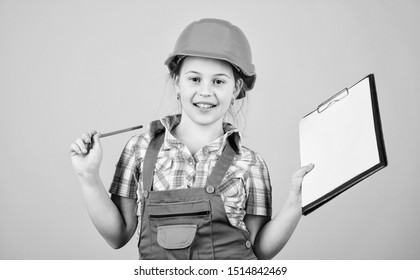 Child care development. Build your future yourself. Initiative child girl hard hat builder worker. Safety expert. Foreman inspector. Builder engineer architect. Future profession. Kid builder girl.