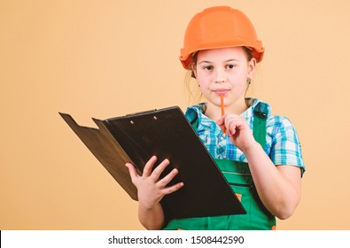 Child care development. Foreman inspector. Repair. Safety expert. Future profession. small girl repairing in workshop. Builder engineer architect. Kid worker in hard hat. examining.