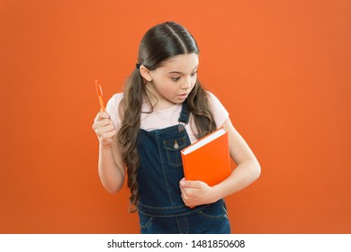 Child care and happy childhood. Study at school. First day at school. Ready for first lesson. September is here. Back to school. Child hold book. Interesting literature. Development and education.