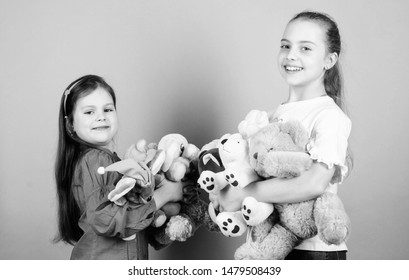 Child care. Sisters best friends play. Sweet childhood. Childhood concept. Softness and tenderness. Charity sale. Love and friendship. Kids adorable cute girls play soft toys. Happy childhood.