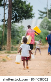 child carrying water can in Uganda Africa