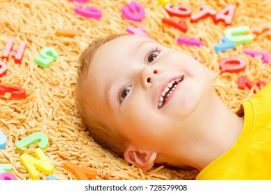 Child caucasian playing with letters beginning of the year first school day.