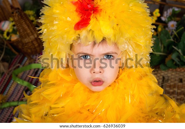 Child in a chicken suit