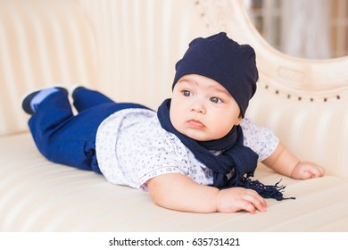 Child, childhood and infant concept - close-up of happy little baby boy at home