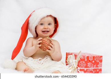 Child with Christmas gifts on a white background.
