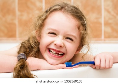 Child cleaning teeth with pleasure