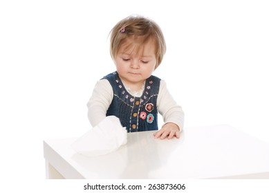 Child cleans Baby wipes white table