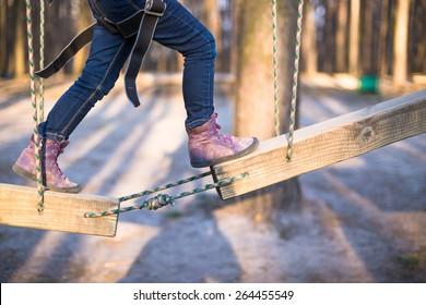 Child climbing on high rope park