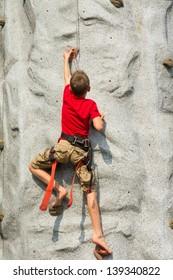 A child climbs on a rock-climbing wall - Tower