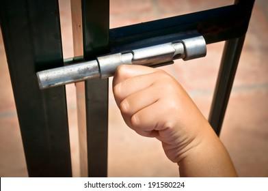 child closing a latch