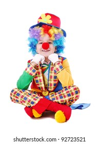 Child clown sitting on the floor