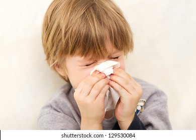 Child cold flu illness tissue blowing runny nose