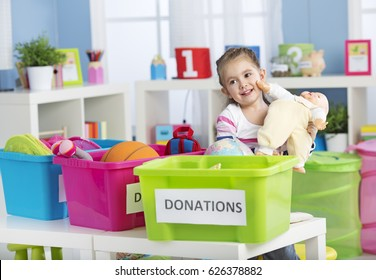 Child collecting toys for humanitarian aid at school