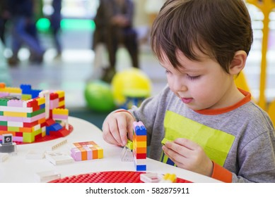 The child collects the Designer. Kids activity in kindergarten or at home