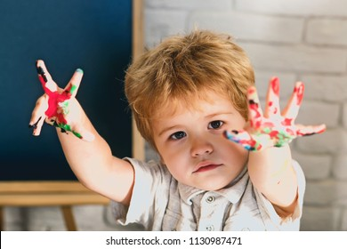 Child with colorful hands. Funny drawing. Creative concept. School or kindergarten. Early learning. Creativity and goods for children. Children shop. Happy talented kid. Rubella or chickenpox disease