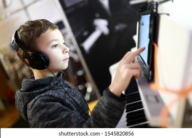 Child controls the synthesizer using a tablet