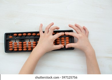 child counting on soroban abacus