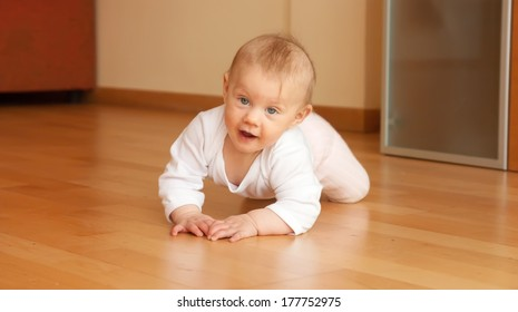 child  crawling on the floor in the room.