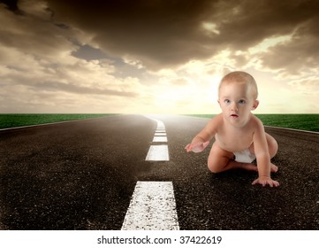 child crawling on a street