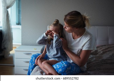 child cries mother soothes