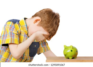 Child crying near the piggy bank. Investment, finances, savings, money, childhood concept.