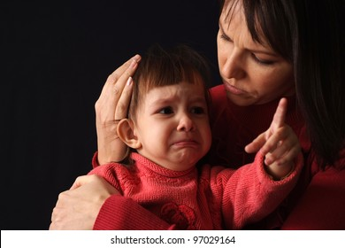 The child was crying on my mother's hands