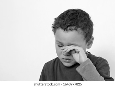 child crying in poverty with no help crying alone and all by himself on white background stock photo