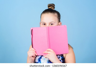Child cute girl hold notepad or diary blue background. Childhood memories. Diary for girls concept. Note secrets down in cute girly diary journal. Keeping secrets here. Keeping her secrets in diary.