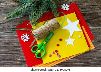 The child cuts out the details christmas tree toys gift. Handmade. Project of children's creativity, handicrafts, crafts for kids.