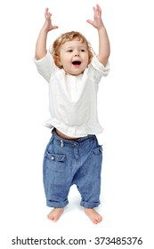 The child dances on a white background, indulge in, runs, plays, hands up