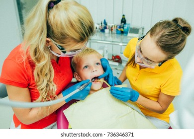 A child at the dental clinic. With the doctors.