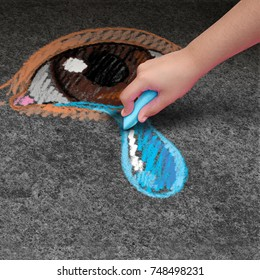Child depression psychology and children mental health concept as a kid with chalk drawing on pavement a human eye with a tear in a 3D illustration style.