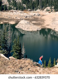 The child descends to the highland Lake Mary. Lake Mary Trail, Uinta-Wasatch-Cache national forest, Utah, United States