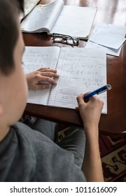 Child do his homework on mathematic