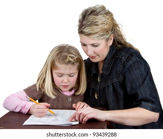 A child does her homework while her mother or teacher helps her, isolated on a white background