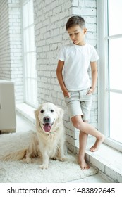 A child with a dog.