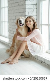 Child with a dog. A girl with labradors at home.