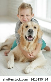Child with a dog at home