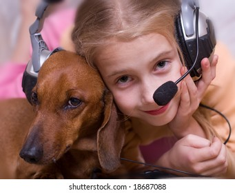 The child and dog listen to music in headphones