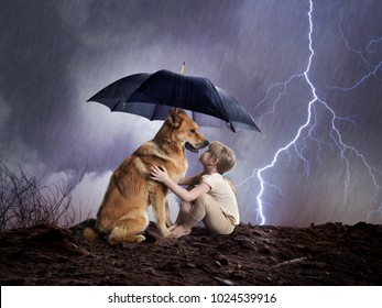 Child and dog under an umbrella.