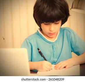 child doing homework, portrait. instagram image retro style