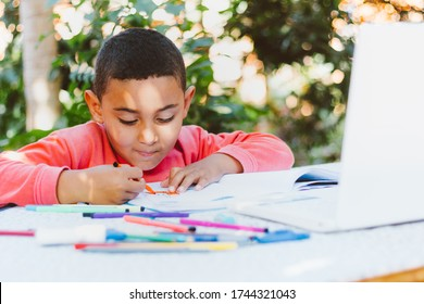 Child doing school lesson at home