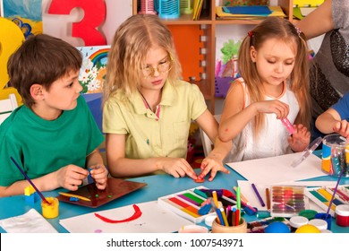 Child dough play in school. Plasticine for children. mold from plasticine in kindergarten .Kids knead modeling clay with hands in preschool. Children's childhood hobby of drawings in classrooms.