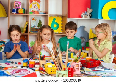Child dough play in school. Plasticine for children. mold from plasticine in kindergarten .Kids knead modeling clay with hands in preschool. Private school for gifted children.