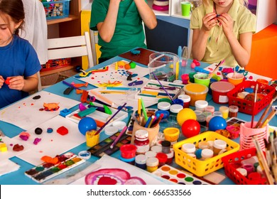 Child dough play in school. Plasticine for children. mold from plasticine in kindergarten .Kids knead modeling clay with hands in preschool. Creative confusion in workplace.