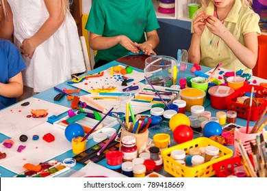 Child dough play in school. Plasticine for children. mold from plasticine in kindergarten .Creative chaos communications. Kids knead modeling clay with hands in preschool.