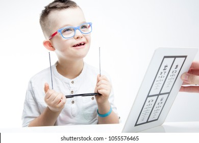 Child with down syndrome. Eye vision therapy.